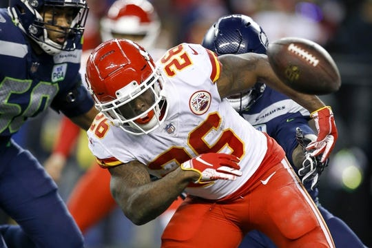 Dec 23, 2018; Seattle, WA, USA; Kansas City Chiefs running back Damien Williams (26) fumbles against the Seattle Seahawks during the second quarter at CenturyLink Field. Mandatory Credit: Joe Nicholson-USA TODAY Sports
