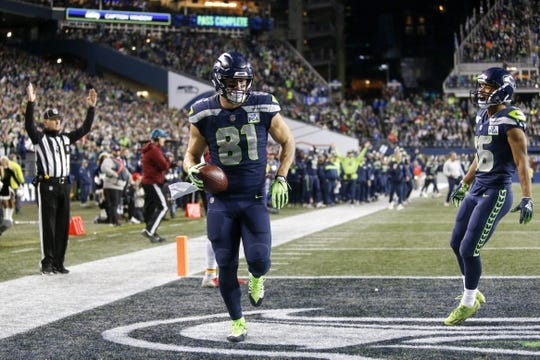 Dec 23, 2018; Seattle, WA, USA; Seattle Seahawks tight end Nick Vannett (81) celebrates with wide receiver Tyler Lockett (16) after catching a touchdown pass against the Kansas City Chiefs during the second quarter at CenturyLink Field. Mandatory Credit: Joe Nicholson-USA TODAY Sports