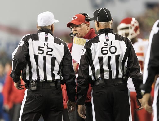 Dec 23, 2018; Seattle, WA, USA; Kansas City Chiefs head coach Andy Reid talks with referee Bill Vinovich (52) and side judge Gary Cavaletto (60) during the first half against the Seattle Seahawks at CenturyLink Field. Mandatory Credit: Steven Bisig-USA TODAY Sports