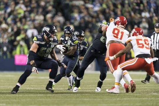 Dec 23, 2018; Seattle, WA, USA; Seattle Seahawks running back Mike Davis (27) carries the ball against the Kansas City Chiefs during the first half at CenturyLink Field. Mandatory Credit: Steven Bisig-USA TODAY Sports