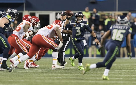 Dec 23, 2018; Seattle, WA, USA; Seattle Seahawks quarterback Russell Wilson (3) passes the ball against the Kansas City Chiefs during the first half at CenturyLink Field. Mandatory Credit: Steven Bisig-USA TODAY Sports