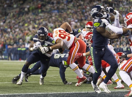 Dec 23, 2018; Seattle, WA, USA; Seattle Seahawks running back Chris Carson (32) carries the ball against the Kansas City Chiefs during the first half at CenturyLink Field. Mandatory Credit: Steven Bisig-USA TODAY Sports