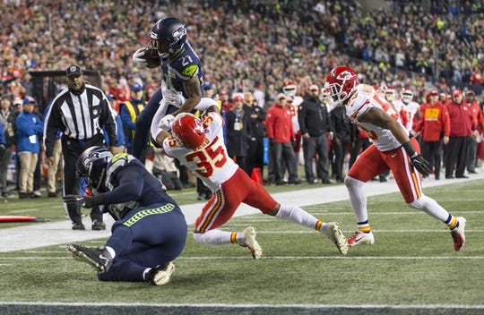 Dec 23, 2018; Seattle, WA, USA; Seattle Seahawks running back J.D. McKissic (21) jumps over Kansas City Chiefs cornerback Charvarius Ward (35) during the first half at CenturyLink Field. Mandatory Credit: Steven Bisig-USA TODAY Sports