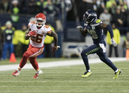 Dec 23, 2018; Seattle, WA, USA; Kansas City Chiefs running back Damien Williams (26) carries the ball against the Seattle Seahawks during the first half at CenturyLink Field. Mandatory Credit: Steven Bisig-USA TODAY Sports