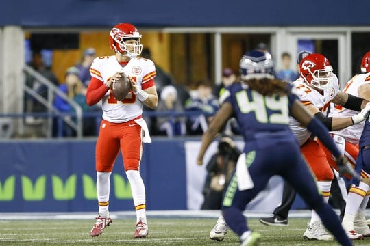 Dec 23, 2018; Seattle, WA, USA; Kansas City Chiefs quarterback Patrick Mahomes (15) looks to pass against the Seattle Seahawks during the first quarter at CenturyLink Field. Mandatory Credit: Joe Nicholson-USA TODAY Sports