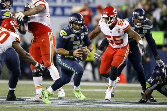 Dec 23, 2018; Seattle, WA, USA; Seattle Seahawks quarterback Russell Wilson (3) scrambles away from Kansas City Chiefs outside linebacker Dee Ford (55) during the second quarter at CenturyLink Field. Mandatory Credit: Joe Nicholson-USA TODAY Sports