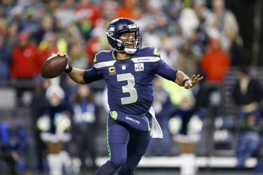 Dec 23, 2018; Seattle, WA, USA; Seattle Seahawks quarterback Russell Wilson (3) passes against the Kansas City Chiefs during the second quarter at CenturyLink Field. Mandatory Credit: Joe Nicholson-USA TODAY Sports