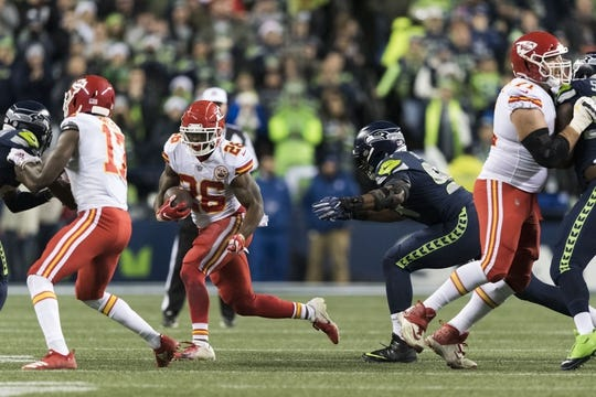 Dec 23, 2018; Seattle, WA, USA; Kansas City Chiefs running back Damien Williams (26) carries the ball against the Seattle Seahawks during the first half at CenturyLink Field. Seattle defeated Kansas City 38-31. Mandatory Credit: Steven Bisig-USA TODAY Sports