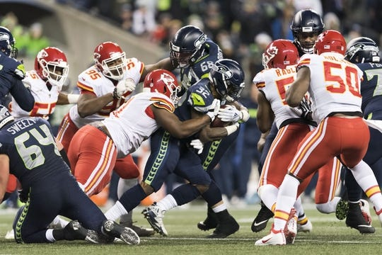 Dec 23, 2018; Seattle, WA, USA; Seattle Seahawks running back Chris Carson (32) carries the ball against the Kansas City Chiefs during the first half at CenturyLink Field. Seattle defeated Kansas City 38-31. Mandatory Credit: Steven Bisig-USA TODAY Sports