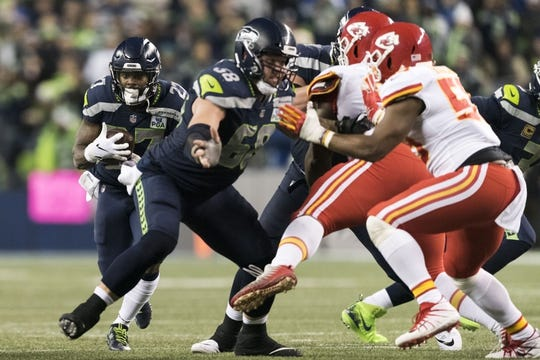 Dec 23, 2018; Seattle, WA, USA; Seattle Seahawks running back Mike Davis (27) carries the ball against the Kansas City Chiefs during the first half at CenturyLink Field. Seattle defeated Kansas City 38-31. Mandatory Credit: Steven Bisig-USA TODAY Sports