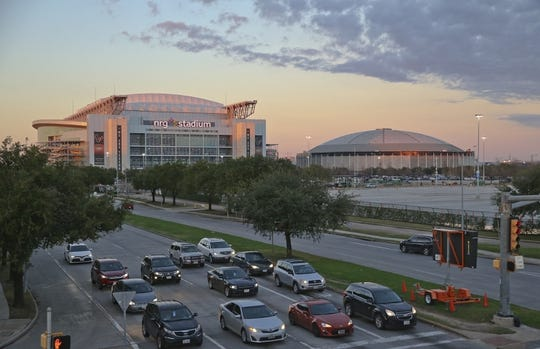 Dec 27, 2018; Houston, TX, United States; The sun sets as on NRG Stadium and the Astros Dome as the Baylor Bears and Vanderbilt Commodores make their way into the stadium in the 2018 Texas Bowl at NRG Stadium. Mandatory Credit: Thomas B. Shea-USA TODAY Sports