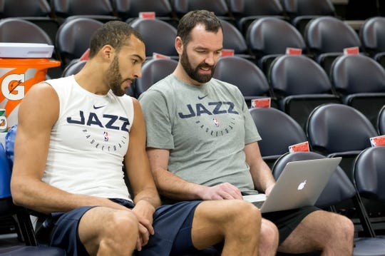 Dec 27, 2018; Salt Lake City, UT, USA; Utah Jazz center Rudy Gobert (left) reviews video with assistant coach Alex Jensen prior to the game against the Philadelphia 76ers at Vivint Smart Home Arena. Mandatory Credit: Russ Isabella-USA TODAY Sports