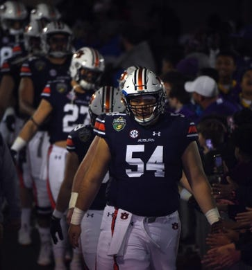 Dec 28, 2018; Nashville, TN, USA; Auburn Tigers offensive lineman Kaleb Kim (54) walks to the field before the game against the Purdue Boilermakers in the 2018 Music City Bowl at Nissan Stadium. Mandatory Credit: Christopher Hanewinckel-USA TODAY Sports