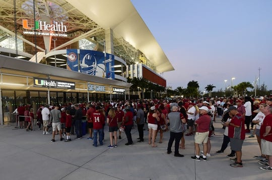 Dec 29, 2018; Miami Gardens, FL, USA; Fans wait in line to get inside Hard Rock Stadium prior to the 2018 Orange Bowl college football playoff semifinal game between the Alabama Crimson Tide and the Oklahoma Sooners. Mandatory Credit: Tommy Gilligan-USA TODAY Sports
