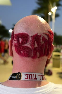 Dec 29, 2018; Miami Gardens, FL, USA; A general view of an Alabama Crimson Tide fans haircut outside of Hard Rock Stadium prior to the 2018 Orange Bowl college football playoff semifinal game against the Oklahoma Sooners. Mandatory Credit: Tommy Gilligan-USA TODAY Sports