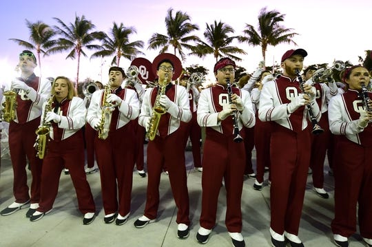 Dec 29, 2018; Miami Gardens, FL, USA; Members of the Oklahoma Sooners marching band preforms outside of Hard Rock Stadium prior to the 2018 Orange Bowl college football playoff semifinal game against the Alabama Crimson Tide. Mandatory Credit: Tommy Gilligan-USA TODAY Sports