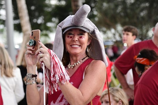 Dec 29, 2018; Miami Gardens, FL, USA; An Alabama Crimson Tide fan smiles for a photo outside of Hard Rock Stadium prior to the 2018 Orange Bowl college football playoff semifinal game against the Oklahoma Sooners at Hard Rock Stadium. Mandatory Credit: Tommy Gilligan-USA TODAY Sports
