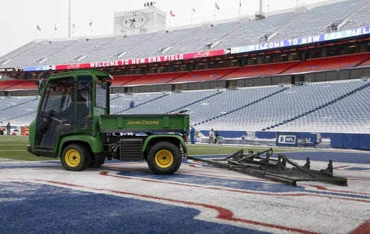 Dec 30, 2018; Orchard Park, NY, USA; Field workers clear snow off the field before a game between the Buffalo Bills and the Miami Dolphins at New Era Field. Mandatory Credit: Timothy T. Ludwig-USA TODAY Sports