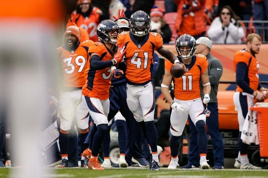 Dec 30, 2018; Denver, CO, USA; Denver Broncos strong safety Will Parks (34) celebrates the interception by cornerback Isaac Yiadom (41) in the first quarter against the Los Angeles Chargers at Broncos Stadium at Mile High. Mandatory Credit: Isaiah J. Downing-USA TODAY Sports