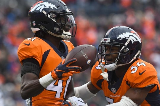 Dec 30, 2018; Denver, CO, USA; Denver Broncos cornerback Isaac Yiadom (41) celebrates his interception with strong safety Will Parks (34) in the first half against the Los Angeles Chargers at Broncos Stadium at Mile High. Mandatory Credit: Ron Chenoy-USA TODAY Sports