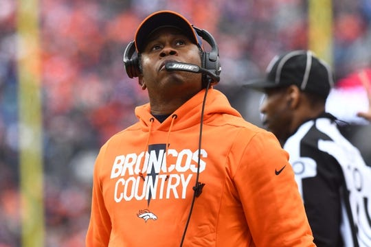Dec 30, 2018; Denver, CO, USA; Denver Broncos head coach Vance Joseph looks at the video board in the first half against the Los Angeles Chargers at Broncos Stadium at Mile High. Mandatory Credit: Ron Chenoy-USA TODAY Sports