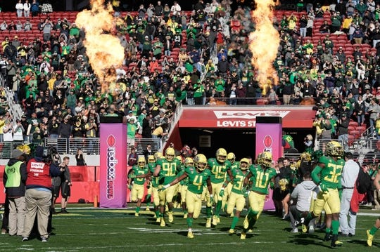 Dec 31, 2018; Santa Clara, CA, USA; Oregon Ducks run onto the field before the game against the Michigan State Spartans at Levi's Stadium. Mandatory Credit: Stan Szeto-USA TODAY Sports