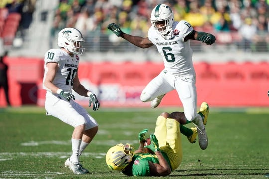 Dec 31, 2018; Santa Clara, CA, USA; Michigan State Spartans safety David Dowell (6) leaps over Oregon Ducks wide receiver Dillon Mitchell (13) near safety Matt Morrissey (10) during the second quarter at Levi's Stadium. Mandatory Credit: Stan Szeto-USA TODAY Sports