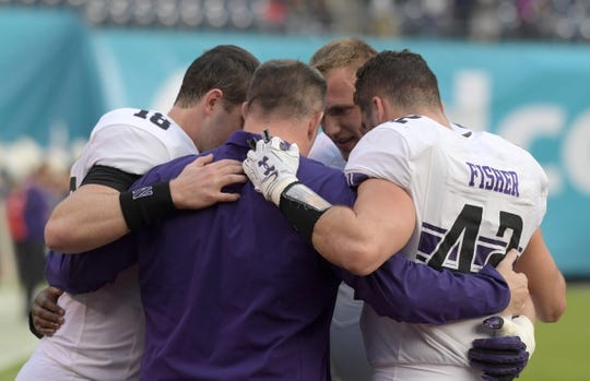 Dec 31, 2018; San Diego, CA, United States; Northwestern Wildcats head coach Pat Fitzgerald huddles with linebacker Paddy Fisher (42), quarterback Clayton Thorson (18) and offensive lineman Tommy Doles (71) during the 2018 Holiday Bowl against the Utah Utes at SDCCU Stadium. Mandatory Credit: Kirby Lee-USA TODAY Sports