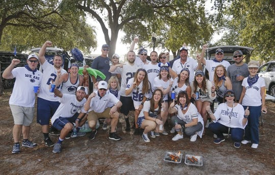 Jan 1, 2019; Orlando, FL, USA; Penn State Nittany Lions fans pose for a photo while tailgating outside Camping World Stadium prior to the Nittany Lions against the Kentucky Wildcats in the 2019 Citrus Bowl. Mandatory Credit: Reinhold Matay-USA TODAY Sports