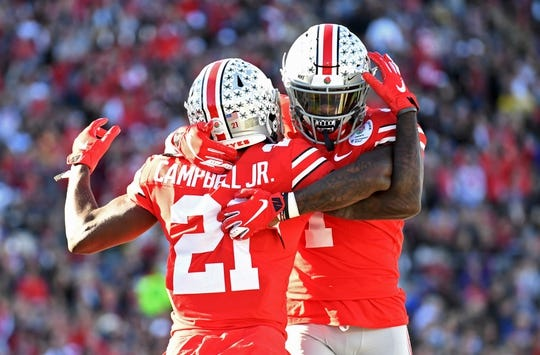 Jan 1, 2019; Pasadena, CA, USA; Ohio State Buckeyes wide receiver Parris Campbell (21) celebrates after making a catch for a touchdown with wide receiver Terry McLaurin (83)  in the first quarter against the Washington Huskies in the 2019 Rose Bowl at Rose Bowl Stadium. Mandatory Credit: Gary A. Vasquez-USA TODAY Sports