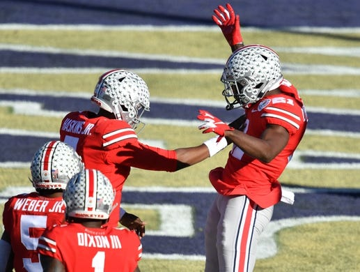 Jan 1, 2019; Pasadena, CA, USA; Ohio State Buckeyes wide receiver Parris Campbell (21) celebrates making a touchdown catch with quarterback Dwayne Haskins (7) in the first quarter against the Washington Huskies in the 2019 Rose Bowl at Rose Bowl Stadium. Mandatory Credit: Robert Hanashiro-USA TODAY Sports