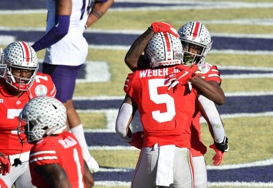 Jan 1, 2019; Pasadena, CA, USA; Ohio State Buckeyes wide receiver Parris Campbell (21) celebrates making a touchdown catch with linebacker Baron Browning (5) in the first quarter against the Washington Huskies in the 2019 Rose Bowl at Rose Bowl Stadium. Mandatory Credit: Robert Hanashiro-USA TODAY Sports