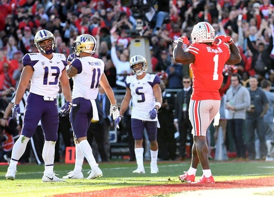 Jan 1, 2019; Pasadena, CA, USA; Ohio State Buckeyes wide receiver Johnnie Dixon (1) celebrates after making a catch for a touchdown against the Washington Huskies in the second quarter in the 2019 Rose Bowl at Rose Bowl Stadium. Mandatory Credit: Gary A. Vasquez-USA TODAY Sports