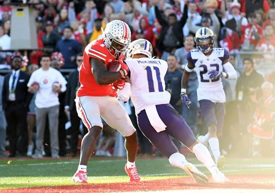 Jan 1, 2019; Pasadena, CA, USA; Ohio State Buckeyes wide receiver Johnnie Dixon (1) makes a catch for a touchdown against Washington Huskies defensive back Brandon McKinney (11) in the second quarter in the 2019 Rose Bowl at Rose Bowl Stadium. Mandatory Credit: Gary A. Vasquez-USA TODAY Sports