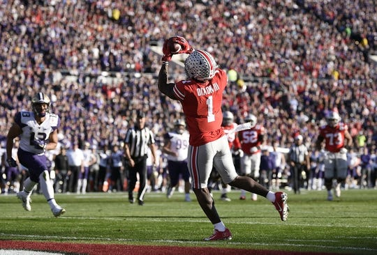 Jan 1, 2019; Pasadena, CA, USA; Ohio State Buckeyes wide receiver Johnnie Dixon (1) makes a catch for a touchdown in the second quarter against the Washington Huskies in the 2019 Rose Bowl at Rose Bowl Stadium. Mandatory Credit: Kelvin Kuo-USA TODAY Sports