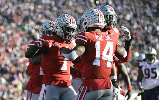 Jan 1, 2019; Pasadena, CA, USA; Ohio State Buckeyes wide receiver Johnnie Dixon (1) celebrates with wide receiver K.J. Hill (14) after making a catch for a touchdown in the second quarter against the Washington Huskies in the 2019 Rose Bowl at Rose Bowl Stadium. Mandatory Credit: Kelvin Kuo-USA TODAY Sports
