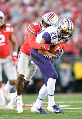 Jan 1, 2019; Pasadena, CA, USA; Ohio State Buckeyes cornerback Kendall Sheffield (8) tackles Washington Huskies wide receiver Ty Jones (20) in the first half in the 2019 Rose Bowl at Rose Bowl Stadium. Mandatory Credit: Gary A. Vasquez-USA TODAY Sports