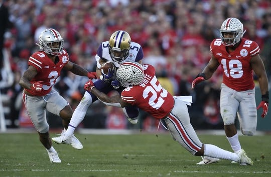 Jan 1, 2019; Pasadena, CA, USA; Washington Huskies wide receiver Andre Baccellia (5) runs against Ohio State Buckeyes safety Brendon White (25) in the first half in the 2019 Rose Bowl at Rose Bowl Stadium. Mandatory Credit: Kelvin Kuo-USA TODAY Sports