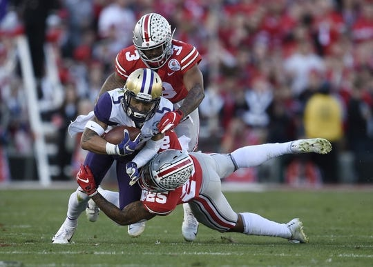 Jan 1, 2019; Pasadena, CA, USA; Washington Huskies wide receiver Andre Baccellia (5) runs against Ohio State Buckeyes safety Brendon White (25) and cornerback Damon Arnette (3) in the first half in the 2019 Rose Bowl at Rose Bowl Stadium. Mandatory Credit: Kelvin Kuo-USA TODAY Sports