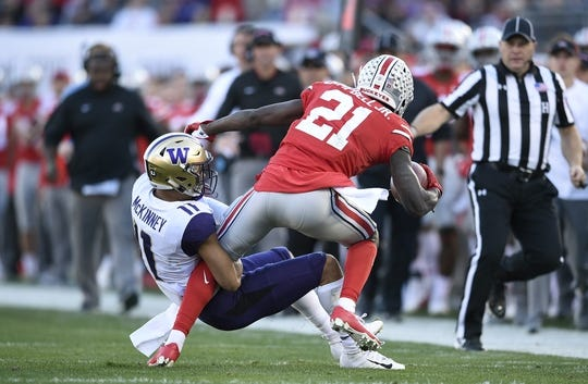 Jan 1, 2019; Pasadena, CA, USA; Washington Huskies defensive back Brandon McKinney (11) tackles Ohio State Buckeyes wide receiver Parris Campbell (21)in the 2019 Rose Bowl at Rose Bowl Stadium. Mandatory Credit: Kelvin Kuo-USA TODAY Sports
