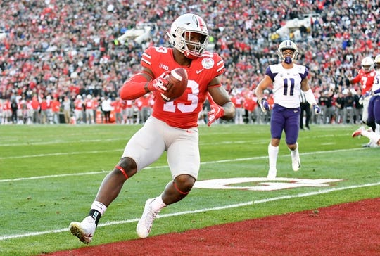 Jan 1, 2019; Pasadena, CA, USA; Ohio State Buckeyes tight end Rashod Berry (13) makes a catch for a touchdown in the first half against the Washington Huskies in the 2019 Rose Bowl at Rose Bowl Stadium. Mandatory Credit: Gary A. Vasquez-USA TODAY Sports