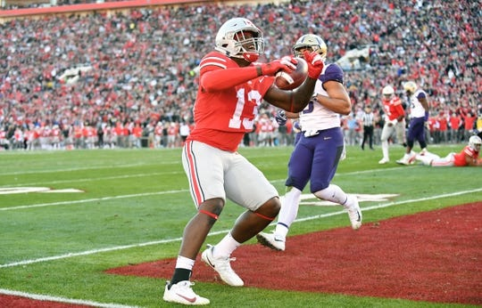 Jan 1, 2019; Pasadena, CA, USA; Ohio State Buckeyes tight end Rashod Berry (13) celebrates after making a catch for a touchdown in the first half against the Washington Huskies in the 2019 Rose Bowl at Rose Bowl Stadium. Mandatory Credit: Gary A. Vasquez-USA TODAY Sports
