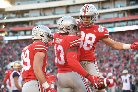 Jan 1, 2019; Pasadena, CA, USA; Ohio State Buckeyes tight end Rashod Berry (13) celebrates after making a catch for a touchdown in the first half with Ohio State Buckeyes defensive end Javontae Jean-Baptiste (38) and tight end Luke Farrell (89) against the Washington Huskies in the 2019 Rose Bowl at Rose Bowl Stadium. Mandatory Credit: Gary A. Vasquez-USA TODAY Sports