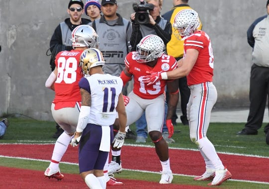 Jan 1, 2019; Pasadena, CA, USA; Ohio State Buckeyes tight end Rashod Berry (13) celebrates with tight end Jeremy Ruckert (88) and tight end Luke Farrell (89) after making a catch for a touchdown in the first half against the Washington Huskies in the 2019 Rose Bowl at Rose Bowl Stadium. Mandatory Credit: Robert Hanashiro-USA TODAY Sports