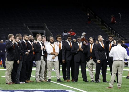 Jan 1, 2019; New Orleans, LA, USA; Texas Longhorns offensive lineman Patrick Vahe (center) poses for a picture before the game between the Georgia Bulldogs and the Texas Longhorns with the defense in the 2019 Sugar Bowl at Mercedes-Benz Superdome. Mandatory Credit: Stephen Lew-USA TODAY Sports