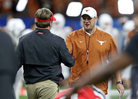Jan 1, 2019; New Orleans, LA, USA; Georgia Bulldogs head coach Kirby Smart greets Texas Longhorns head coach Tom Herman before the 2019 Sugar Bowl at the Mercedes-Benz Superdome. Mandatory Credit: Chuck Cook-USA TODAY Sports