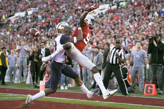 Jan 1, 2019; Pasadena, CA, USA; Washington Huskies defensive back Jordan Miller (23) is called for a pass interference on Ohio State Buckeyes wide receiver Binjimen Victor (9) while defending a pass in the end zone in the 2019 Rose Bowl at Rose Bowl Stadium. Mandatory Credit: Kelvin Kuo-USA TODAY Sports