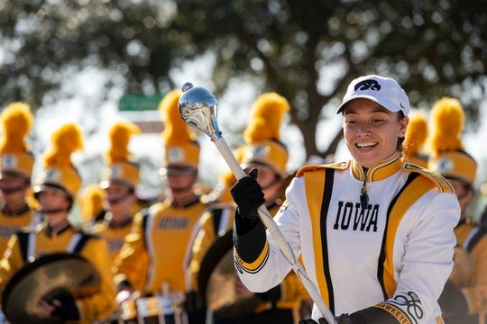 Jan 1, 2019; Tampa, FL, USA; Iowa Hawkeyes marching band drum major performs in front of the stadium prior to the game between the Mississippi State Bulldogs and the Iowa Hawkeyes in the 2019 Outback Bowl at Raymond James Stadium. Mandatory Credit: Douglas DeFelice-USA TODAY Sports