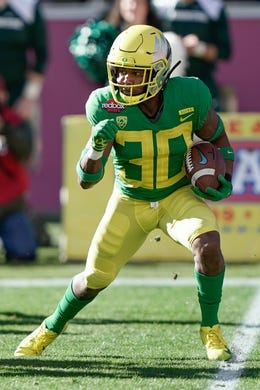 Dec 31, 2018; Santa Clara, CA, USA; Oregon Ducks wide receiver Jaylon Redd (30) runs with the football against the Michigan State Spartans during the first quarter at Levi's Stadium. Mandatory Credit: Stan Szeto-USA TODAY Sports
