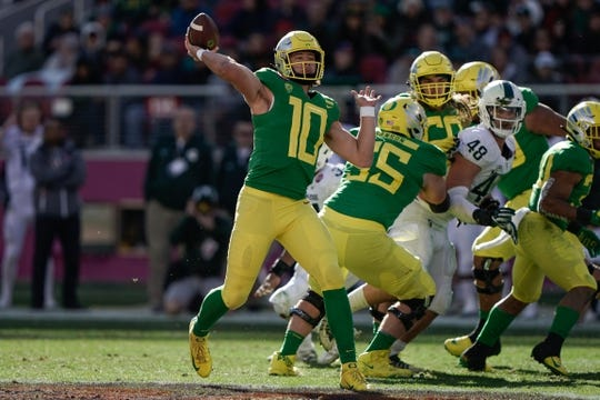 Dec 31, 2018; Santa Clara, CA, USA; Oregon Ducks quarterback Justin Herbert (10) throws the football against the Michigan State Spartans during the second quarter at Levi's Stadium. Mandatory Credit: Stan Szeto-USA TODAY Sports
